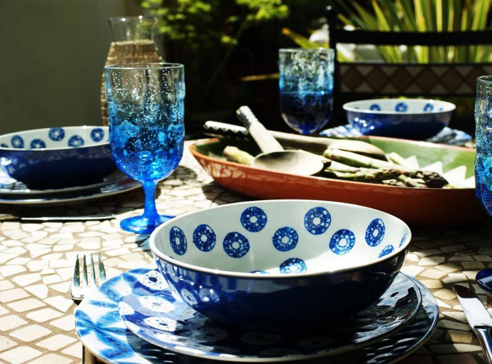 The blue and white Indigo range from M&S, with matching wine goblets and the green and terracotta Alvitoserving platter from Habitat.