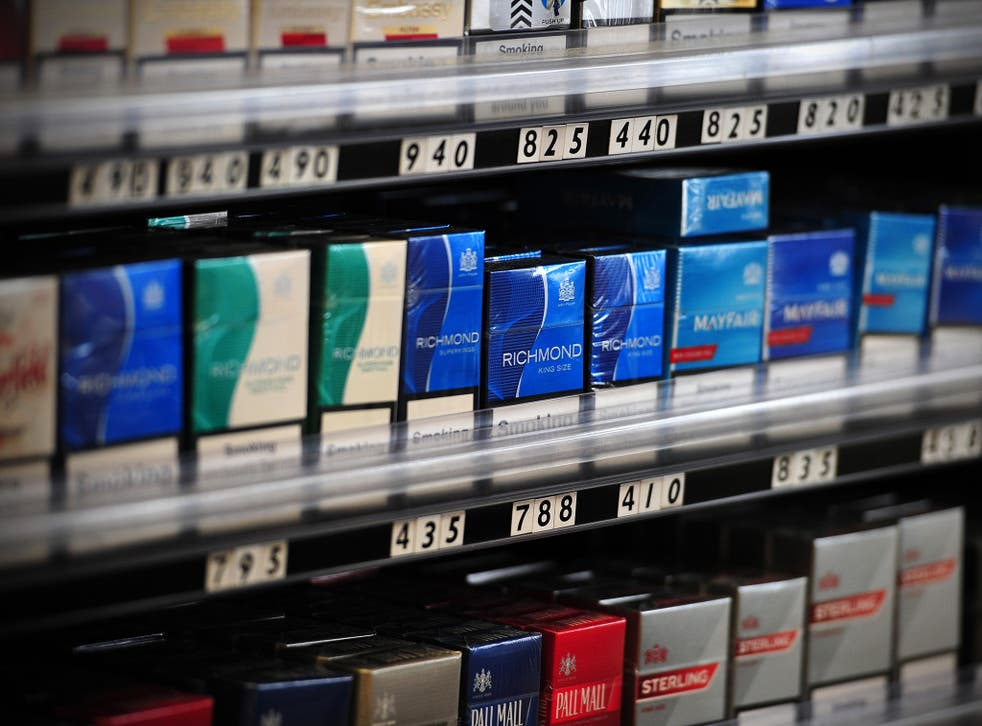 Tobacco companies are seeking compensation over plain packaging laws, set to be introduced in 2016