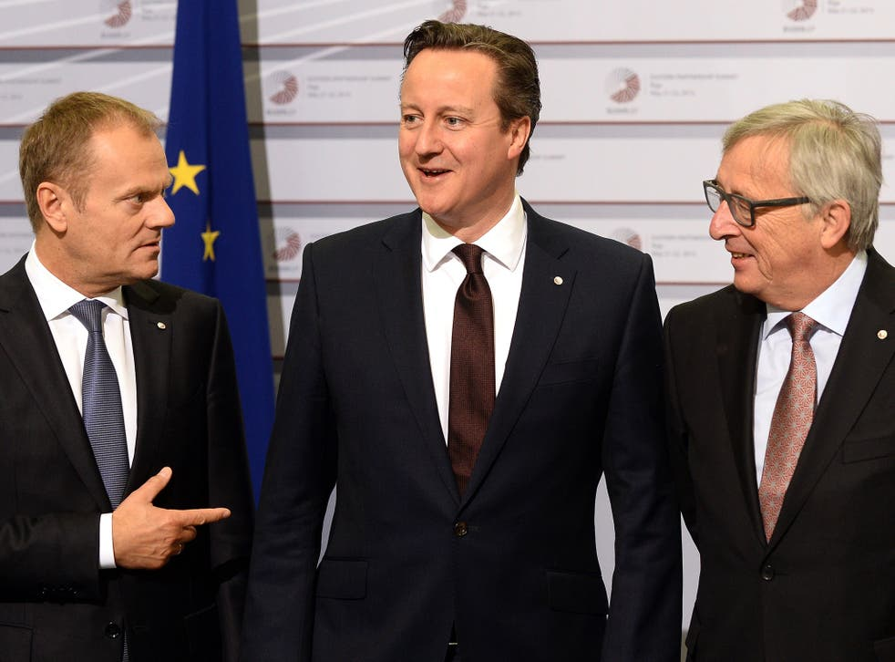 Cameron alongside the President of the European Commission Jean-Claude Juncker and President of the European Council Donald Tusk (L)