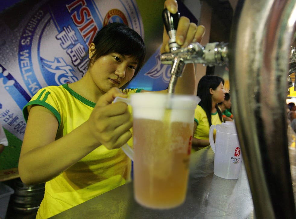 A bartender fills a pitcher of beer at a beer garden in Qingdao, 24 August 2007, in eastern China's Shandong province during the traditional Beer Festival month in the hometown of China's most famous beer, Tsingtao.