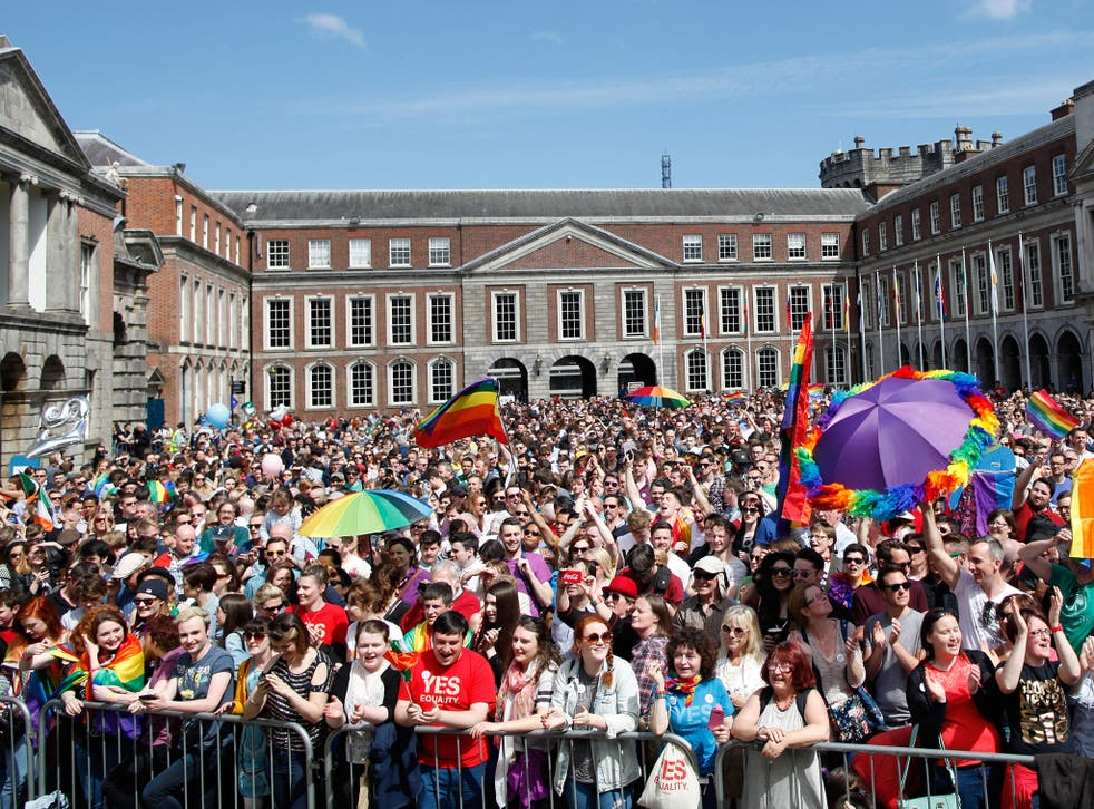 In the courtyard in front of Dublin Castle hundreds of men, women and children draped in rainbow flags hugged, cheered and cried