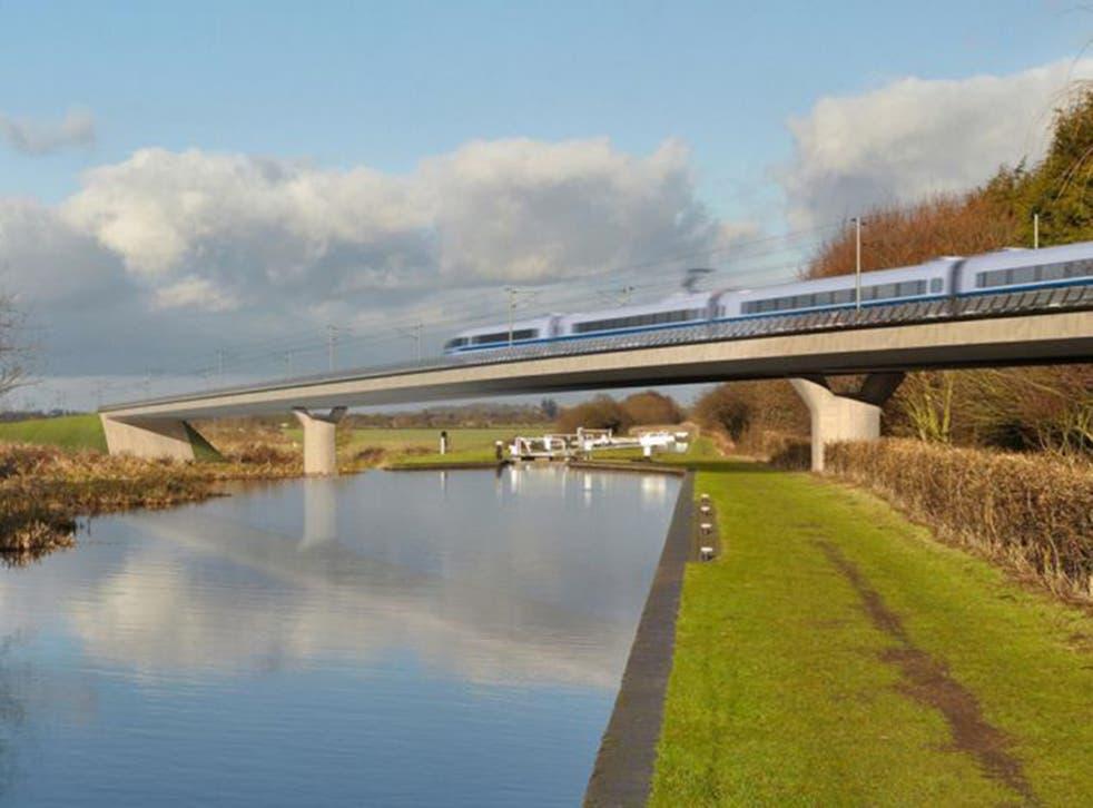 An HS2 train crosses a viaduct near Birmingham, in this artist's impression