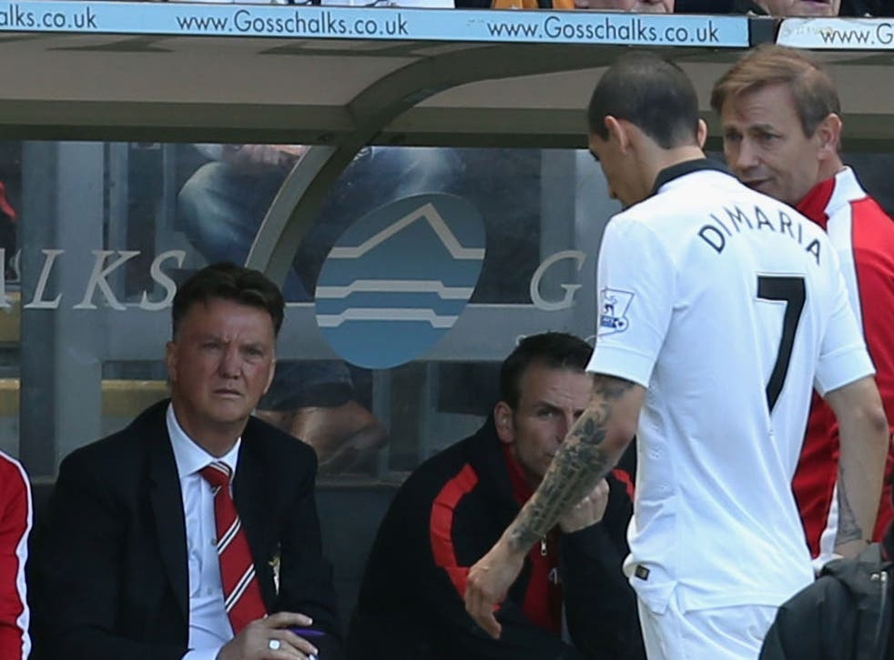 Angel Di Maria comes off on the final day of the season, watched by Louis van Gaal