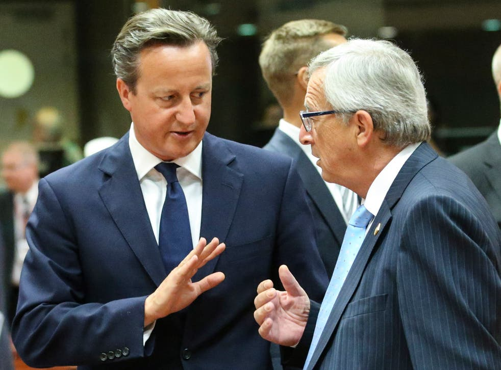 British Prime Minister David Cameron talks with President-elect of the European Commission Jean-Claude Juncker at the start of a Special Meeting of the European Council at EU Council headquarters in Brussels