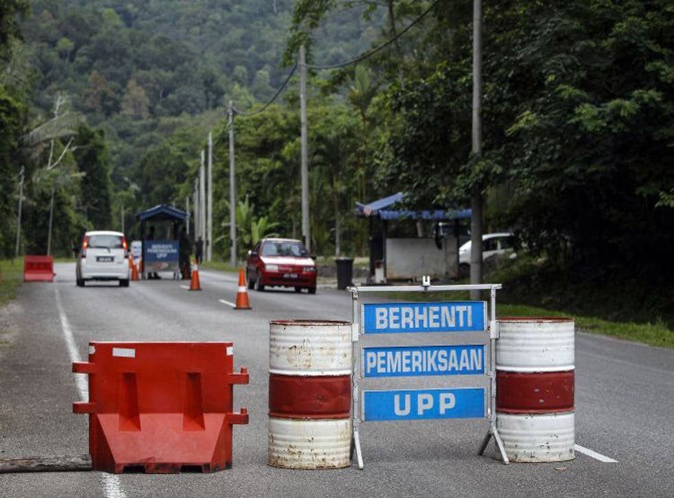 A check point is seen at the entry point to Malaysia - Thailand border in Wang Kelian, Malaysia. On Sunday, authorities found human remains in several abandoned plots across the Thai border