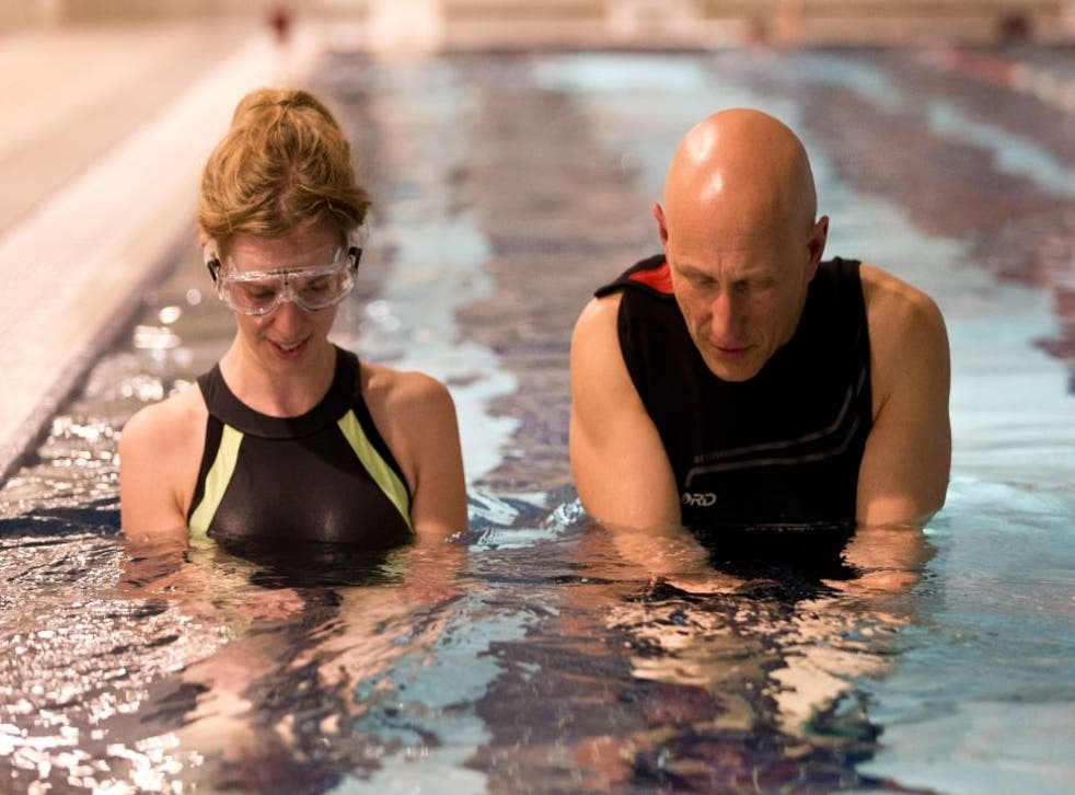 Steve Shaw shows Kate how to get wet behind the ears and how to align her neck