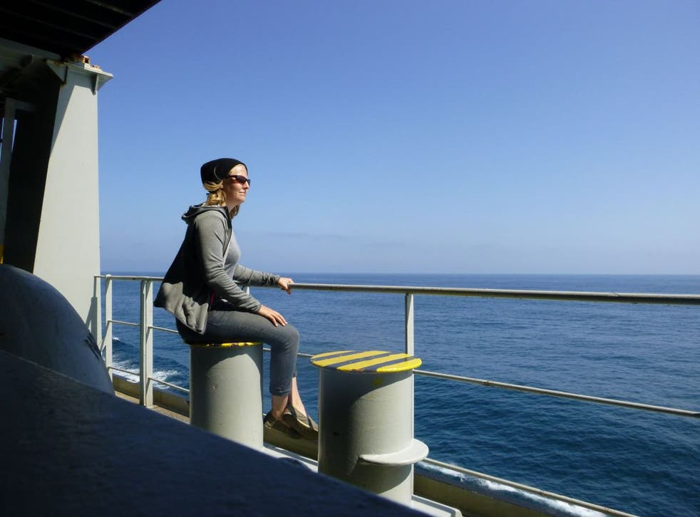 The freight escape: Sarah Royal watching the waves as she crosses the Pacific on a cargo vessel bound for Asia