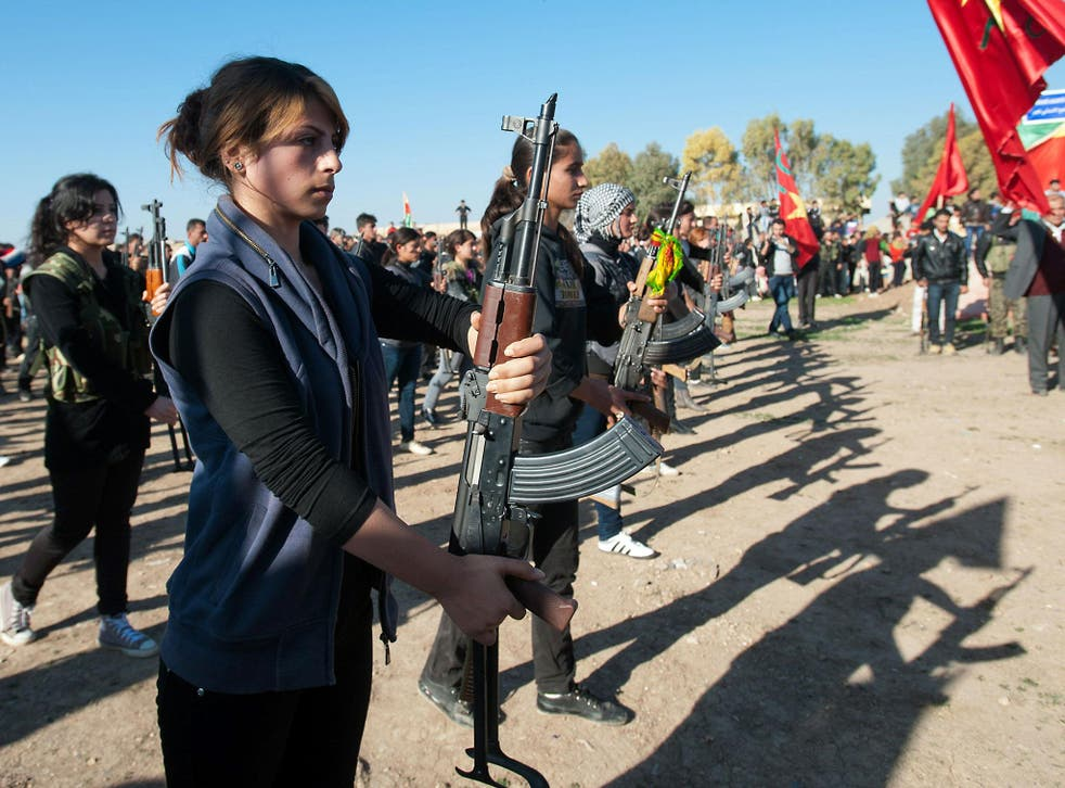 Syrian-Kurdish women and members of the Popular Protection Units (YPG). The road that leads directly to Raqqa, the Isis Syrian capital, is currently threatened by a pincer movement of Kurds