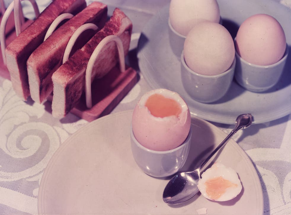 circa 1955: The first meal of the day, boiled eggs and buttered toast for breakfast