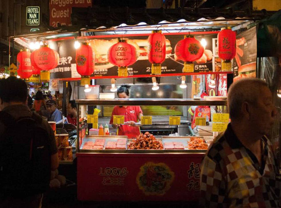 Street smart: food vendor in Chinatown (Getty)