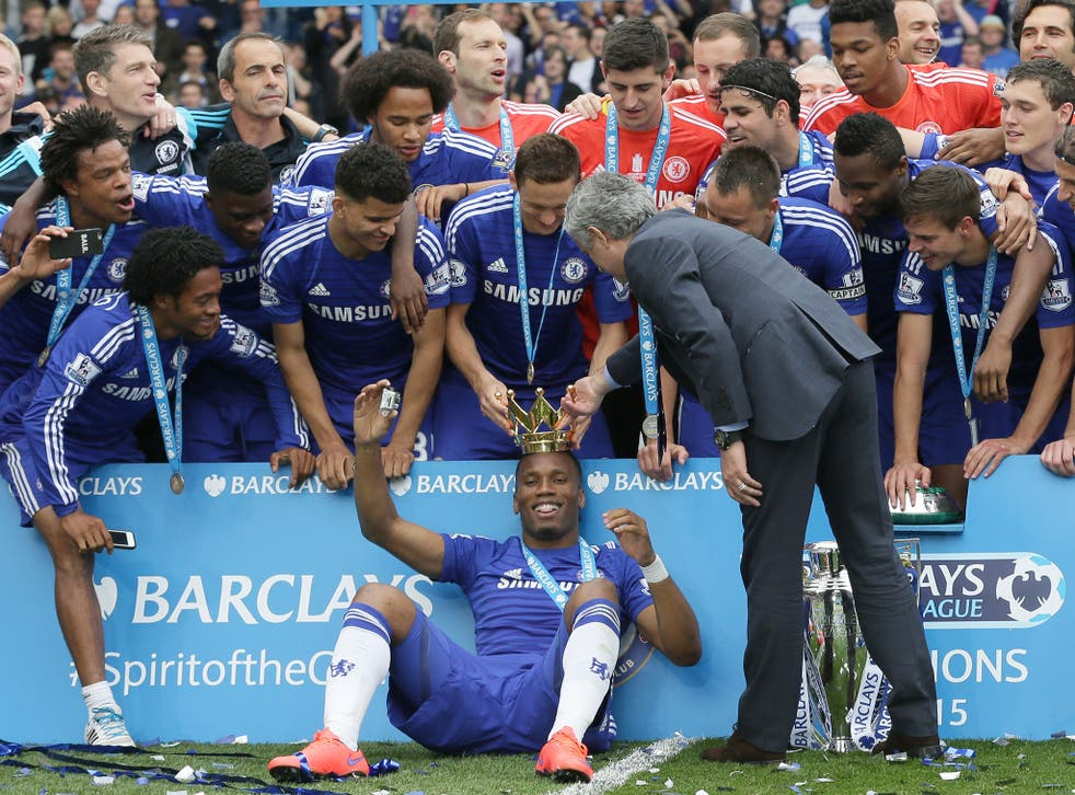 Chelsea players celebrate with the trophy after the English Premier League soccer match between Chelsea and Sunderland at Stamford Bridge stadium in London. Chelsea were awarded the trophy after winning the English Premier League