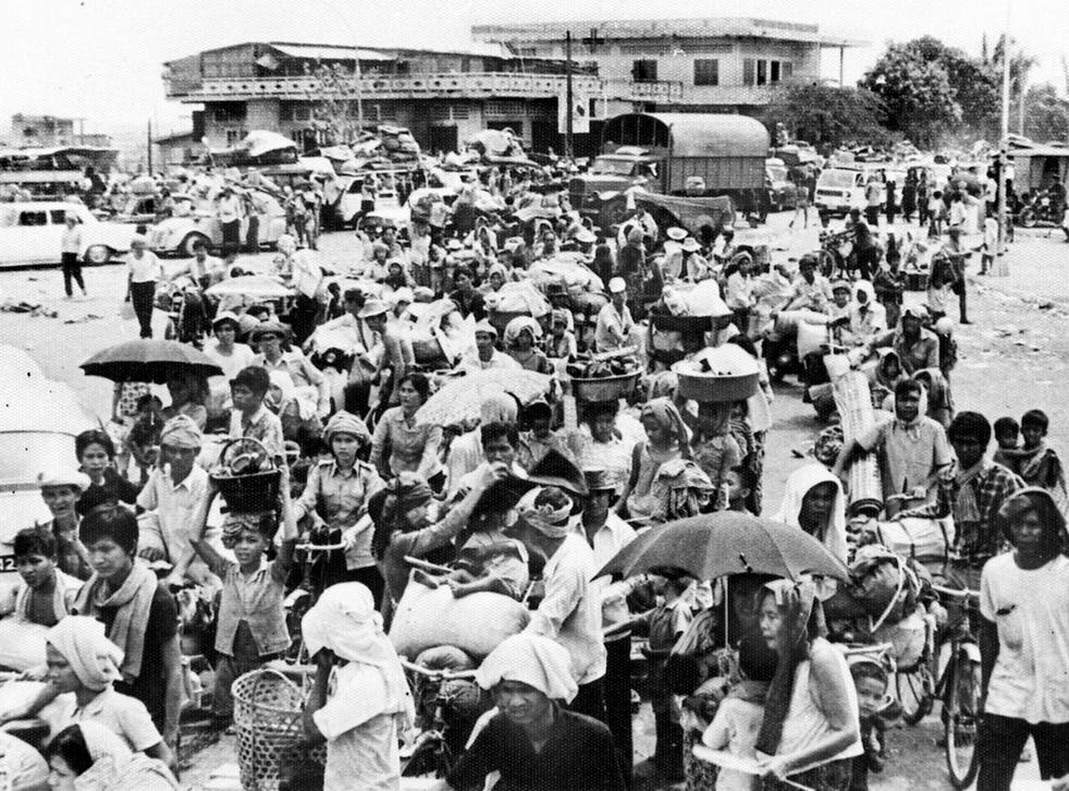 Driven from the city: families flee Phnom Penh after Khmer Rouge forces seize the Cambodian capital in April 1975