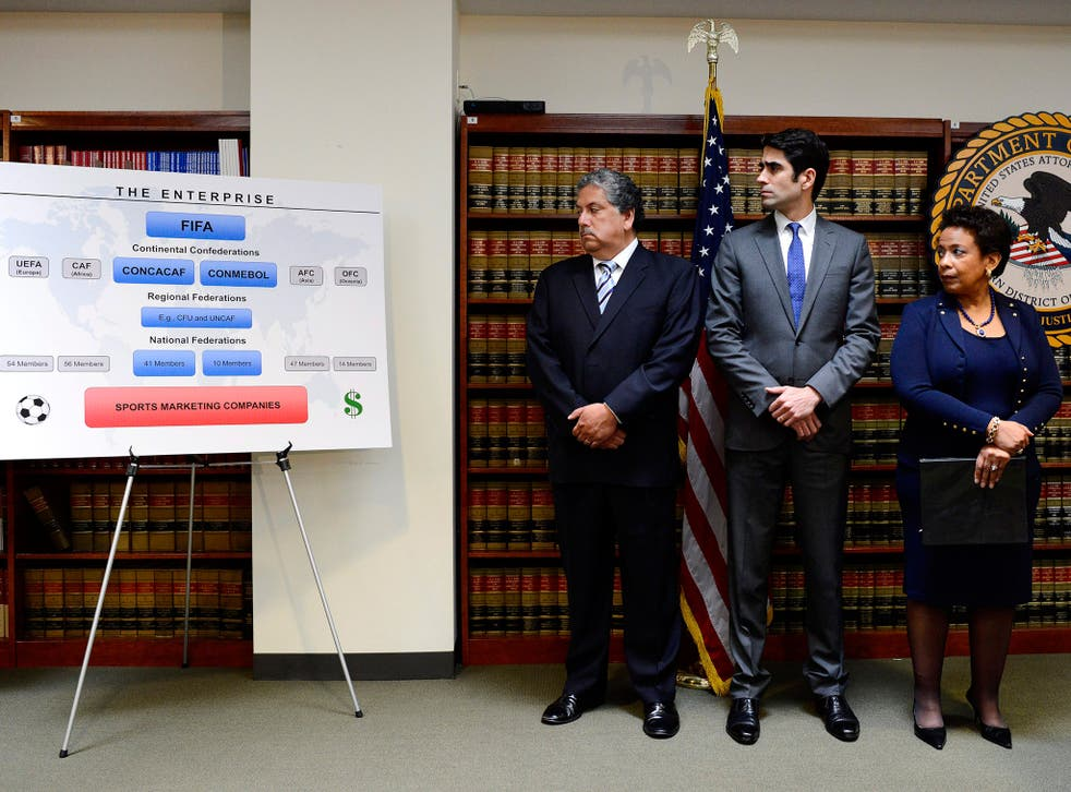 United States Attorney General Loretta E. Lynch, right, federal prosecutor Evan Norris, centre, and a representative from the Internal Revenue Service attend a press conference about the arrests of nine FIFA officials in Brooklyn, New York