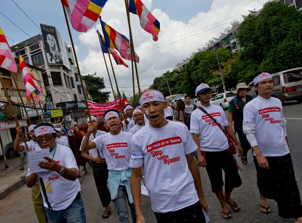 Buddhist nationalists shout slogans during a rally in Rangoon, Burma. Protesters, led by Buddhist monks, claim the boat people are from Bangladesh rather than Rohingya Muslims