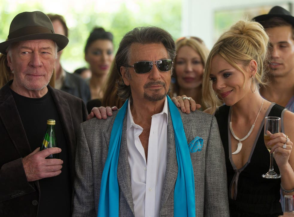 Al Pacino flanked by Christopher Plummer and Katarina Cas in 'Danny Collins'