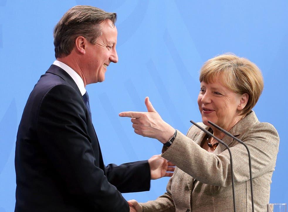 Angela Merkel and David Cameron say goodbye in the Bundeskanzleramt after their meeting in Berlin, Germany, 29 May 2015