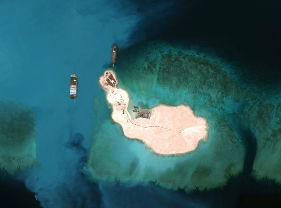 Cargo is unloaded on one of an artificially constructed island in the South China Sea