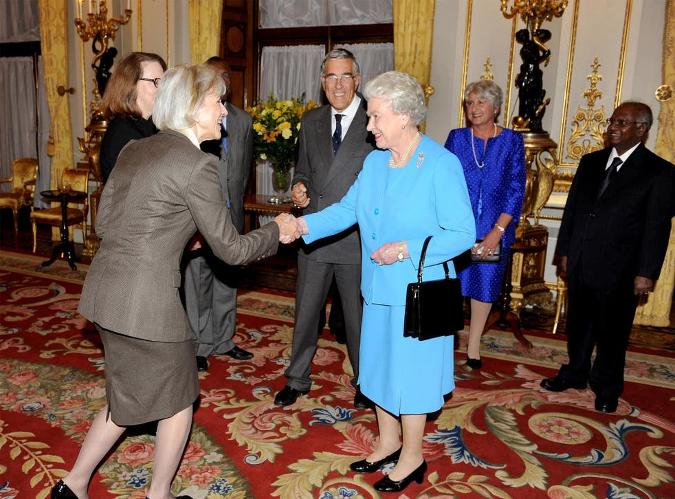 """Chief justice of the Supreme Court, Beverley McLachlin, who said that Canada attempted to commit """"cultural genocide"""" against aboriginal peoples, meets Queen Elizabeth II on October 15, 2009, in London, England"""