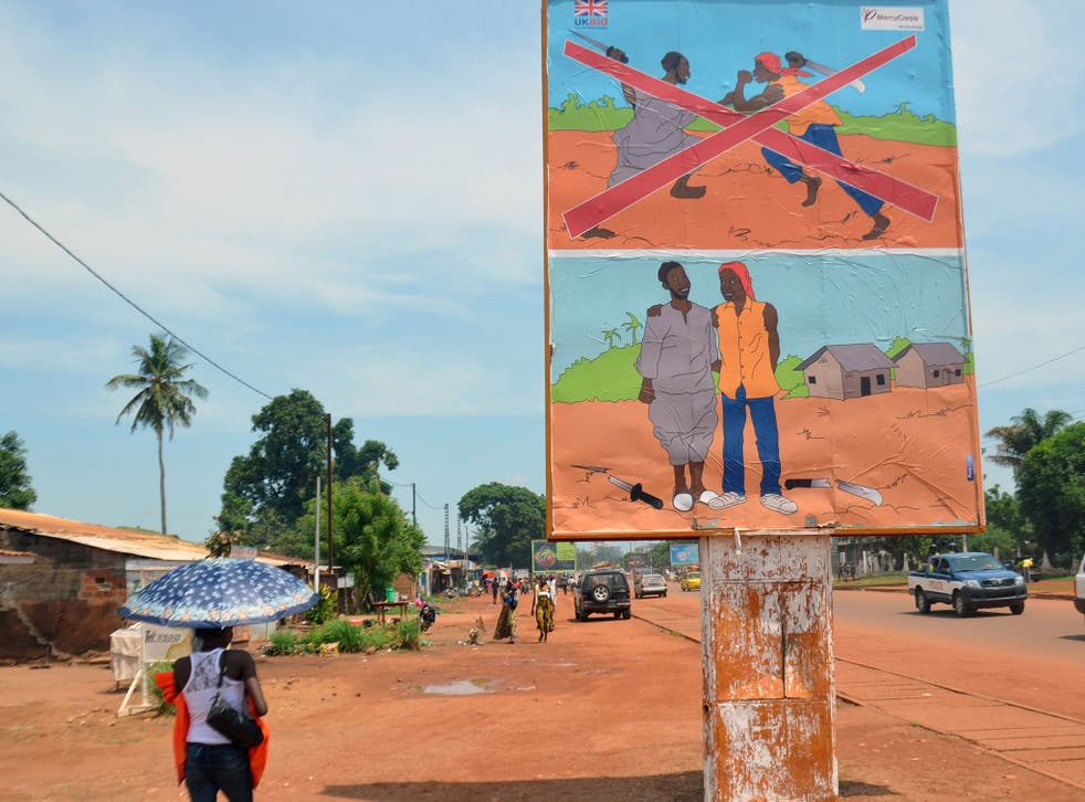 A sign at the entrance to the KM5 market in Bangui. A nearby banner implores 'Let Us Reconcile'