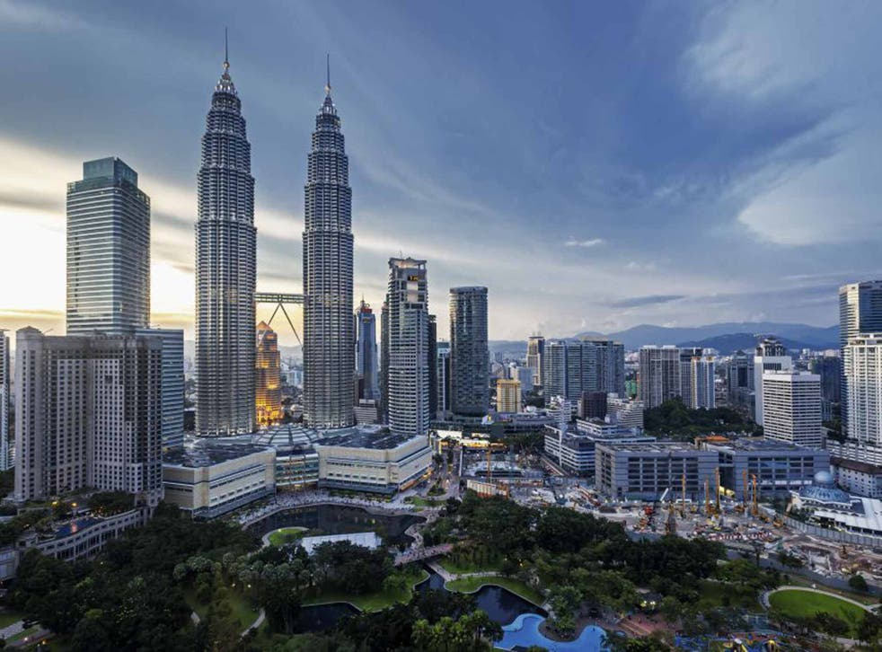 The Petronas Twin Towers rise above the city