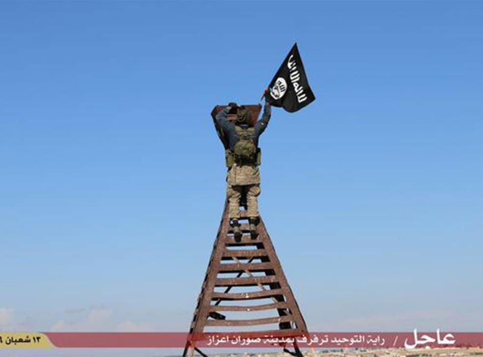An image shared by Isis-supporting social media accounts claimed to show the raising of the Isis flag in the town of Soran Azaz