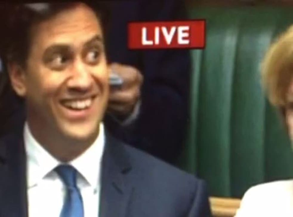 Ed Miliband catches the eye of a colleague as he returns to the backbenches for the first time since his election defeat