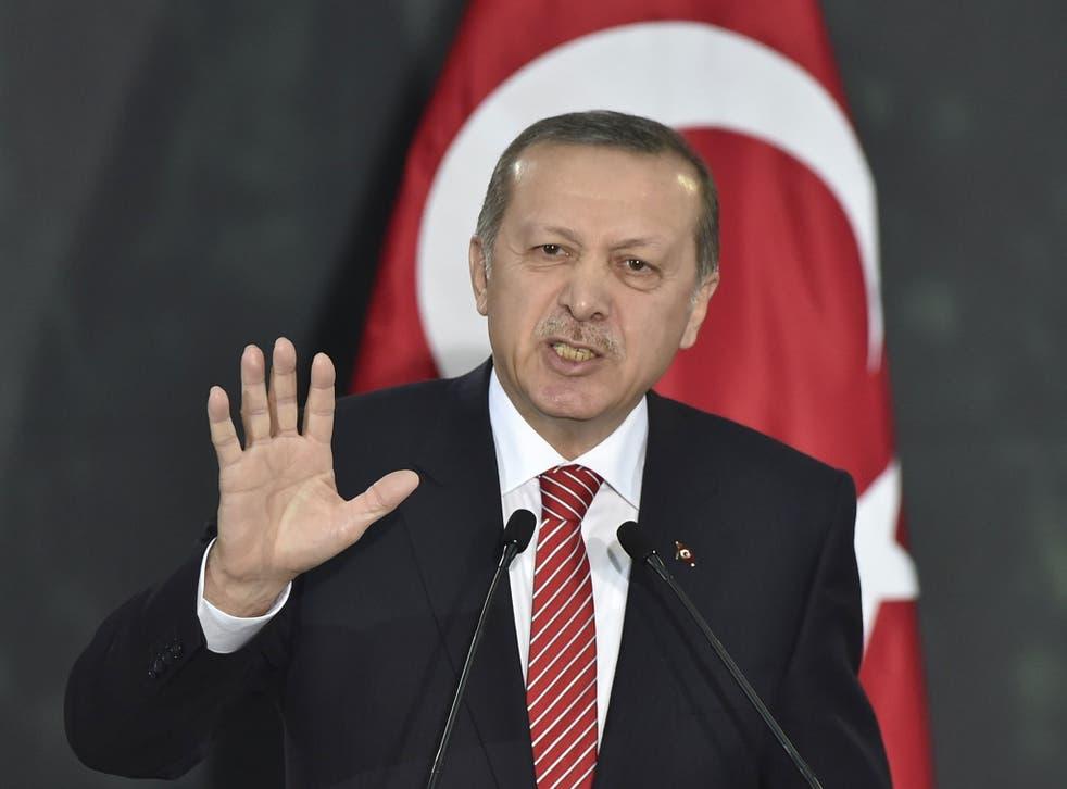 "Turkish President Recep Tayyip Erdogan has said the editor of Cumhuriyet will ""pay a high price"""