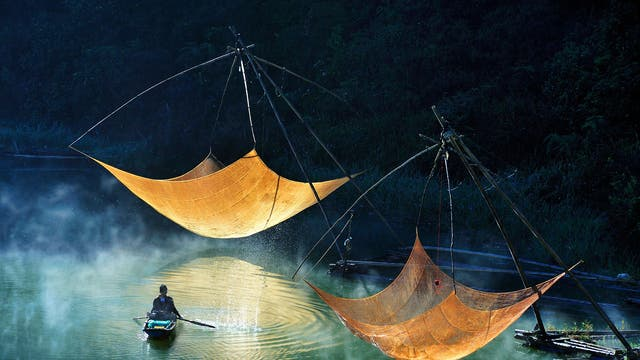 Fishermen check their nets in Vietnam. The marine economy is one of the strongest economic sectors of Vietnam; it is targeted to reach 53 to 55 percent of GDP by 2020 and to comprise more than 60 percent of the country's export turnover