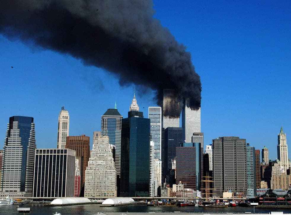 The twin towers of the World Trade Center billow smoke after hijacked airliners crashed into them early 11 September, 2001