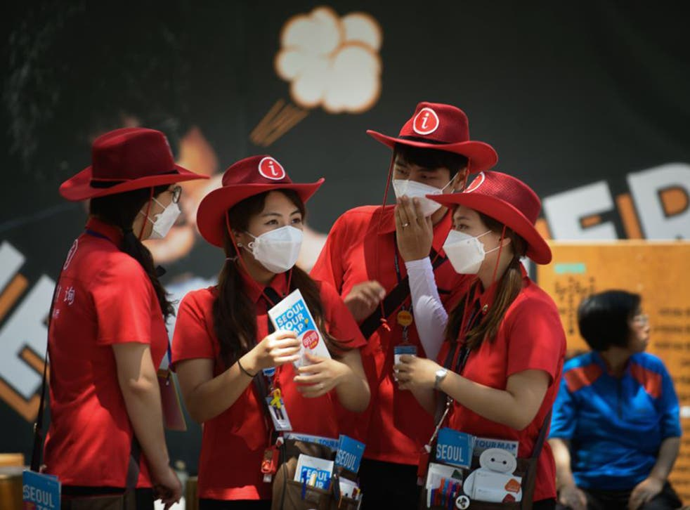 Volunteer tourist assistants in Seoul are attempting to reassure foreign visitors amid reports that 7,000 people – mostly from China – have cancelled planned trips to South Korea due to Mers