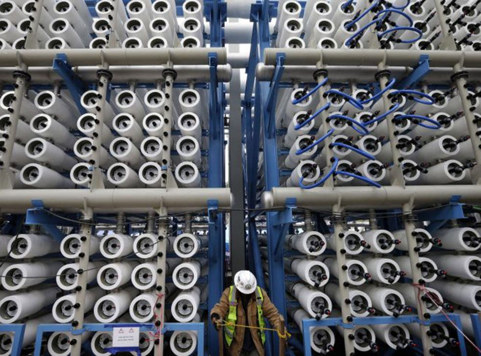 Some of the 2,000 pressure vessels used to convert seawater into fresh water through reverse osmosis at California's Carlsbad Desalination Project