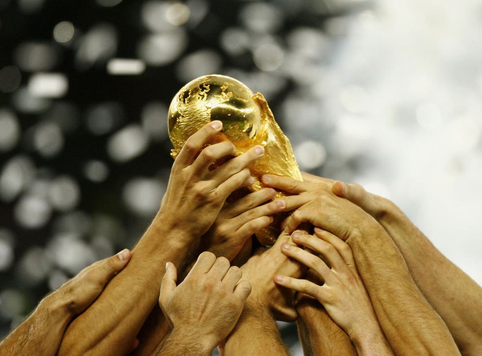 Italian players celebrate with the world cup trophy, following their team's victory during the FIFA World Cup Germany 2006