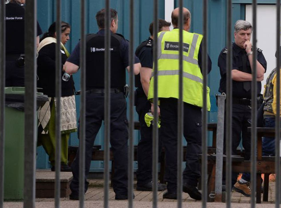 Border Force staff detain some of the 68 people found locked in four lorries at Harwich International Port