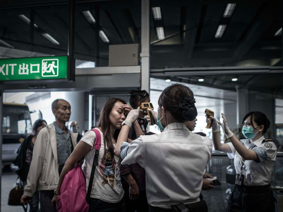 Mers virus outbreak south korean officials argue over spread of passengers get their temperature checked as part of preventive measures against the spread of middle east publicscrutiny Gallery