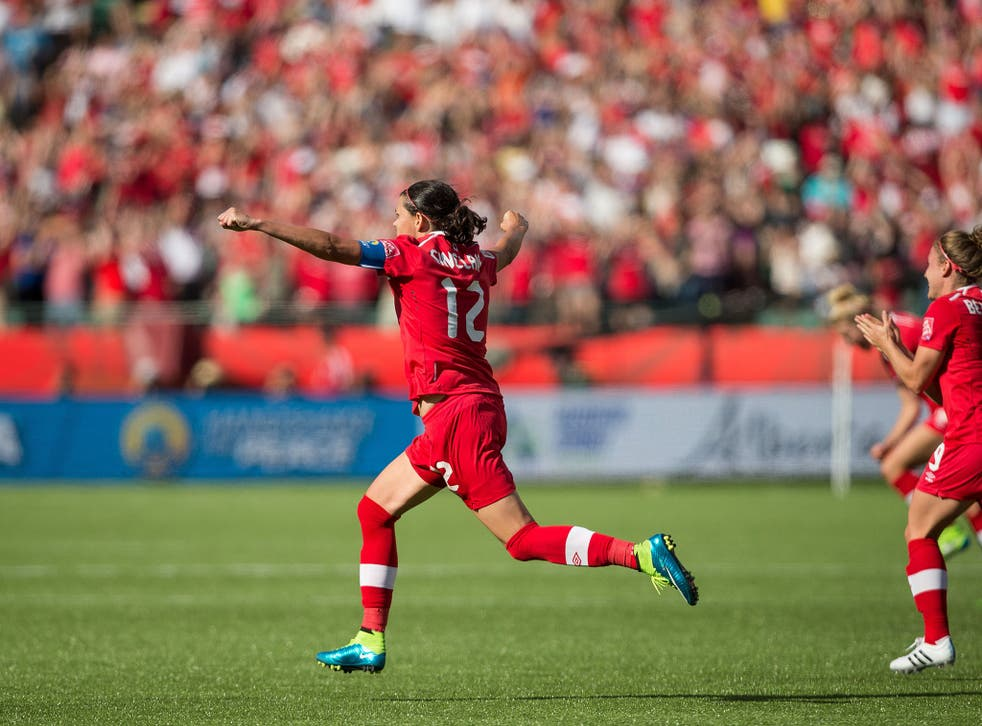 Christine Sinclair celebrates scoring for Canada in the opening game of the Women's World Cup