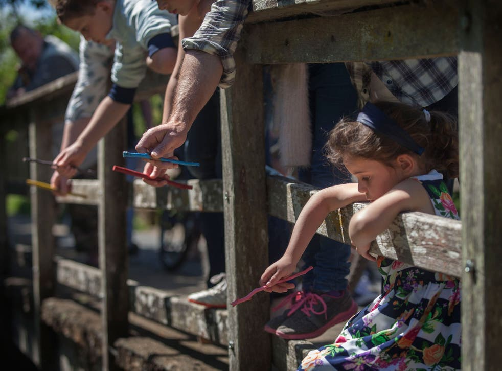 Jessica Blantz at the World Pooh Sticks Championships on the river Windrush in Witney