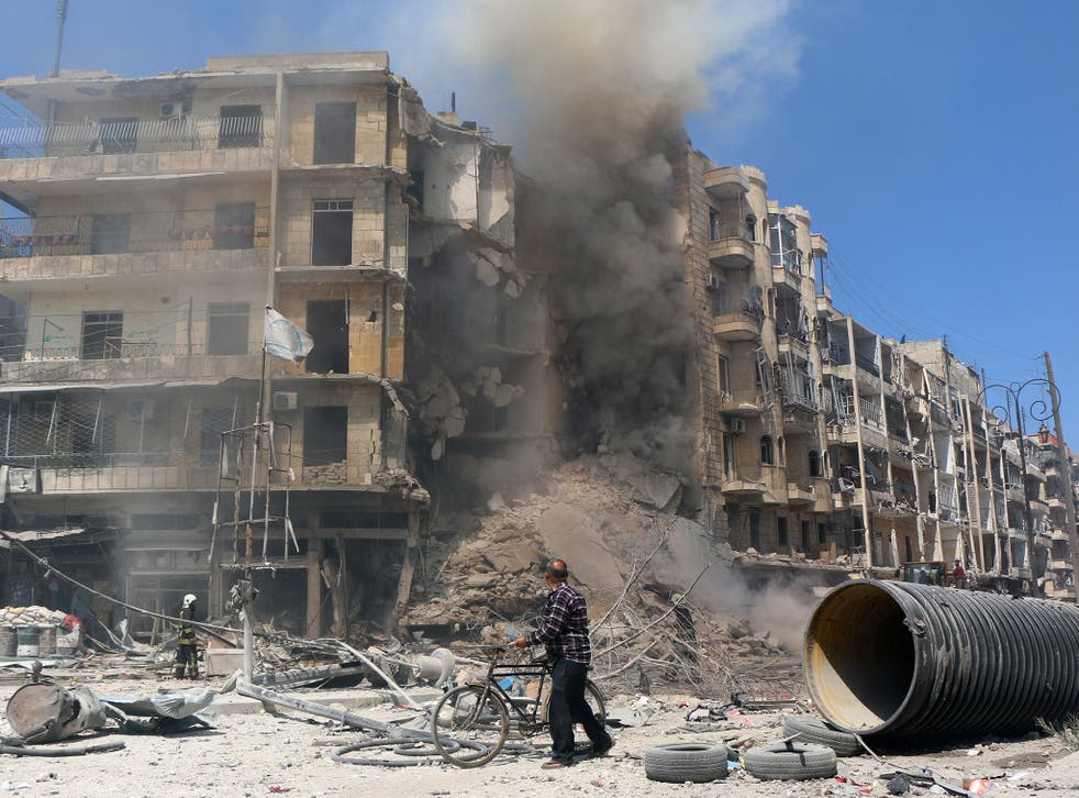 A man walks past the rubble of a building following reported shelling by Syrian government forces in the Bab al-Hadid neighbourhood of the northern city of Aleppo
