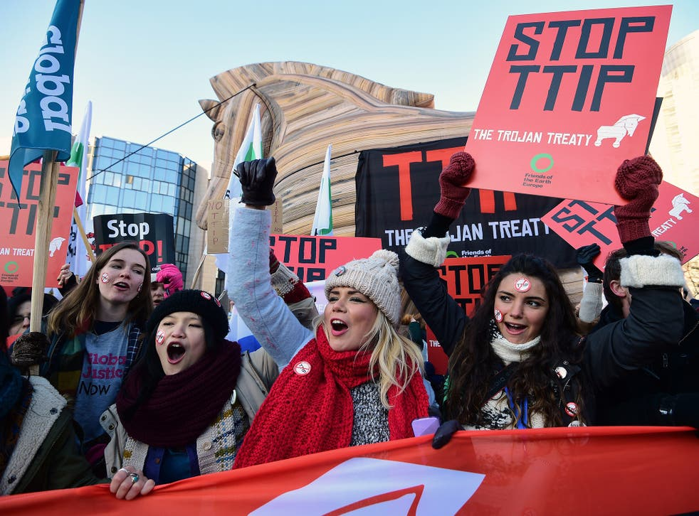 Demonstrators staging a protest against the Transatlantic Trade and Investment Pact (TTIP) in front of the the European institutions in Brussels in February (Getty)