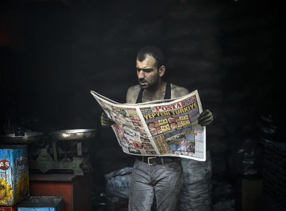 A man catches up on election news in the south-eastern Kurdish city of Diyarbakir. Now Recep Tayyip Erdogan's AKP must weigh up its future strategy