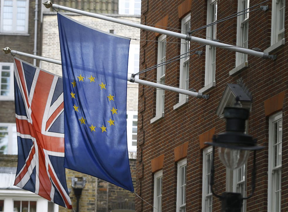 The Union flag and the European Union flag fly outside Europe House,  in London