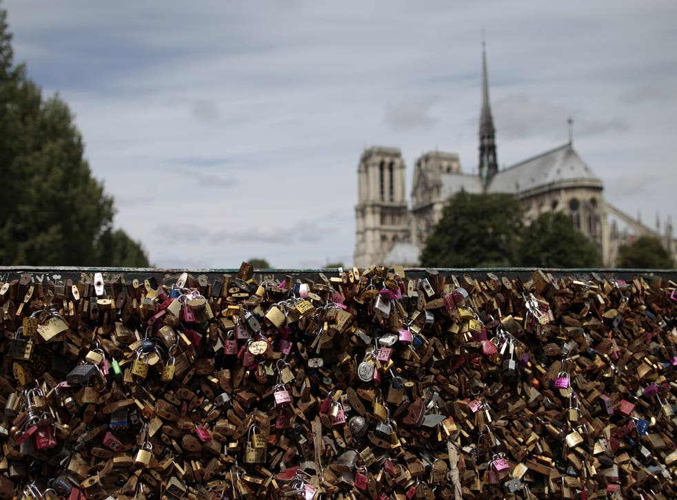 The love padlocks, which had been a romantic ritual for many couples visiting the French capital, will now be sold with proceeds going to refugees in the city