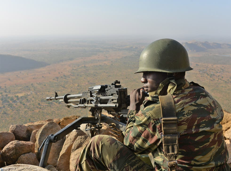 A soldier defends the village of Mabass, in the north of Cameroon, from Boko Haram fighters. The extremist group has killed almost 100 people in Kukawa.