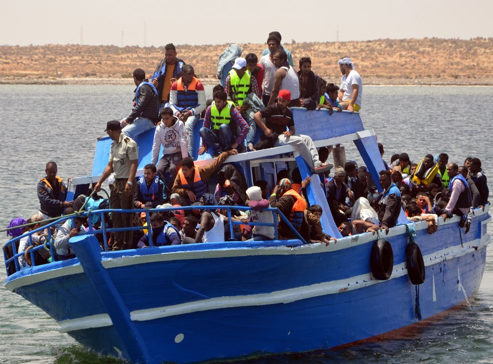 Migrants arrive at the port of Ben Guerdane, Tunisia, some 40 kilometres west of the Libyan border, after their vessel overturned, on Wednesday