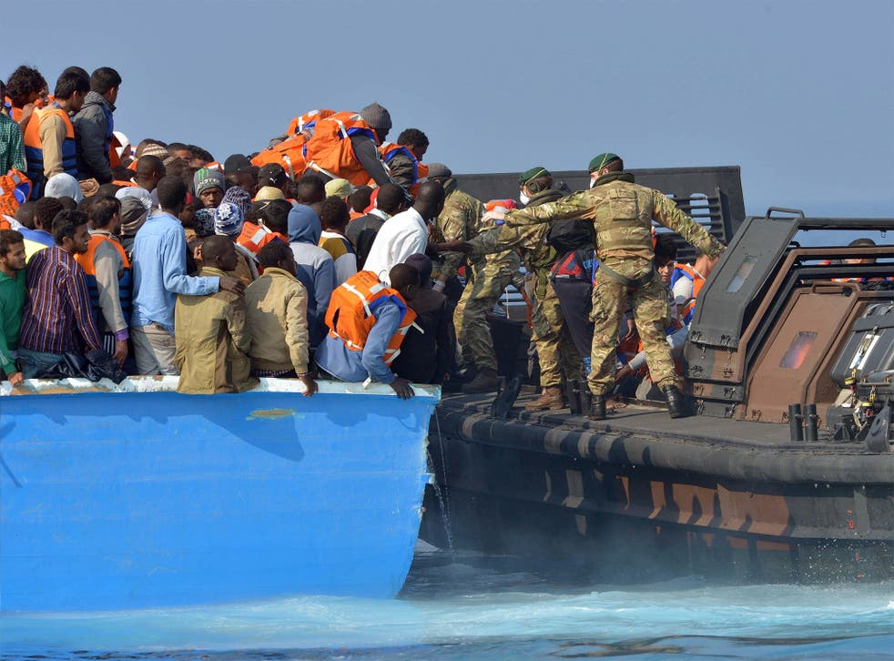 Royal Marines from HMS 'Bulwark' rescue migrants off the coast of Libya