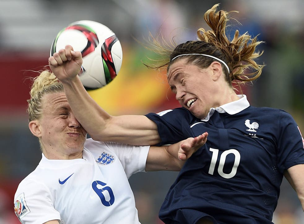Laura Bassett is elbowed in the face by France's Camille Abily