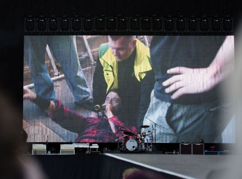 """A screen shows singer of US band """"Foo Fighters"""" Dave Grohl in the background of the empty stage during the band's concert att Nya Ullevi in Gothenburg, Sweden, on June 12, 2015. Grohl broke his leg while performing on stage in Gothenburg."""