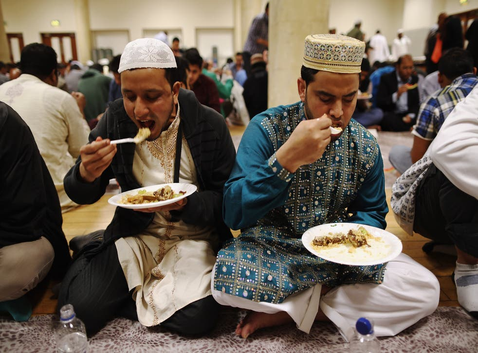 Muslims at the East London Mosque break their fast after a long day of no food or water.