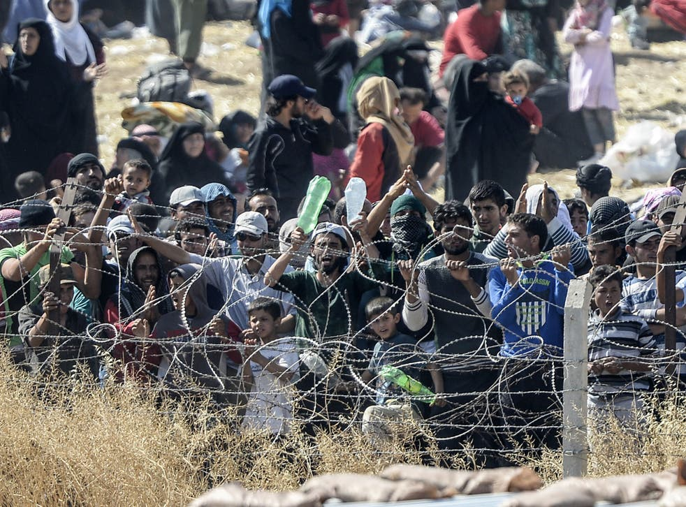 Turkish security forces used water cannon and fired warning shots to push Syrians back from the frontier as thousands massed at a border crossing to escape escalating fighting.  the Turkish border.