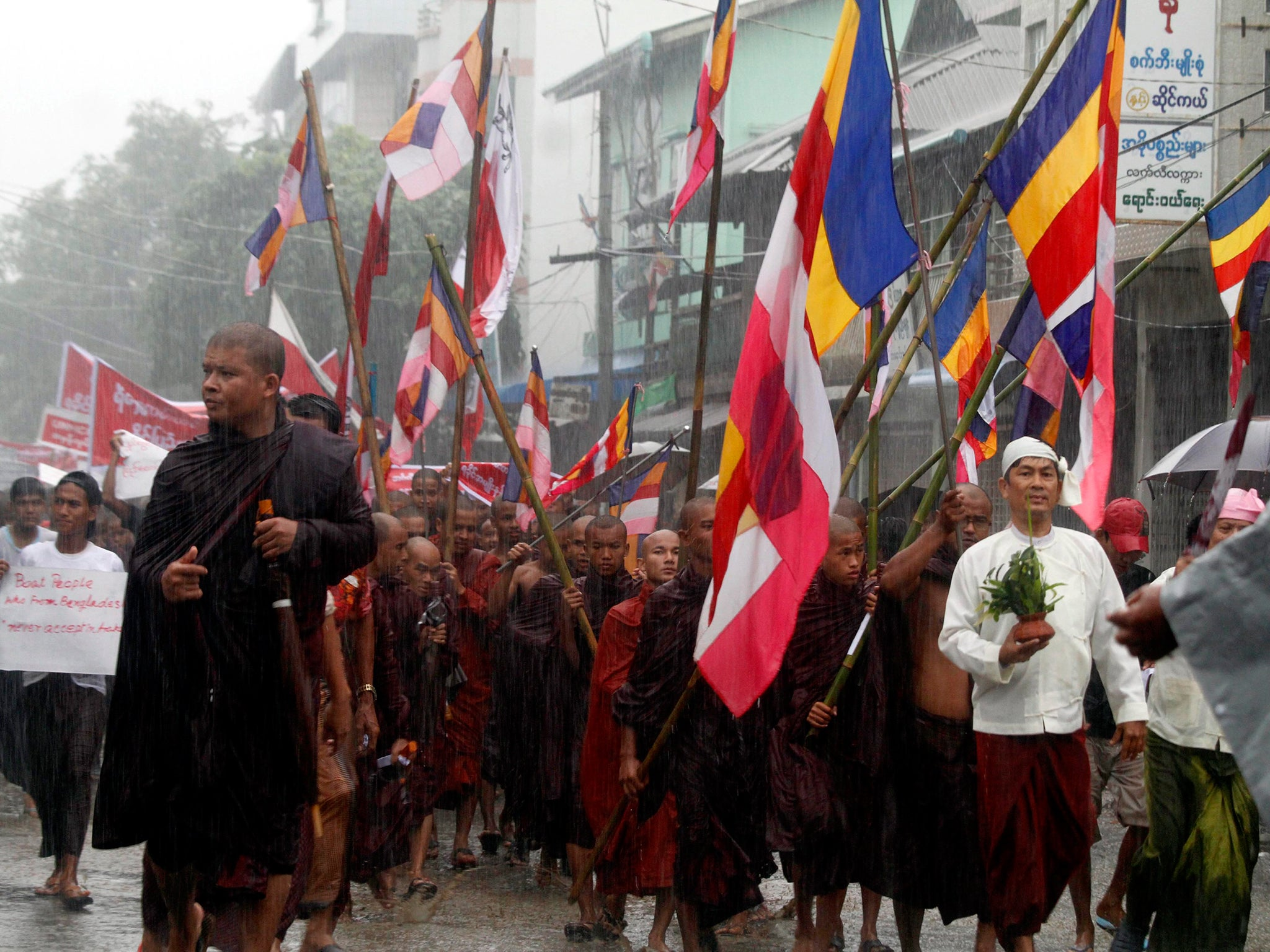 Image result for Hard-line Buddhist monks lead a demonstration against Rohingya migrants who were resettled in Rakhine state after being found at sea while fleeing Burma following anti-Muslim violence