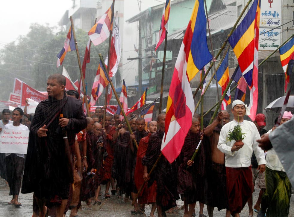 Hard-line Buddhist monks lead a demonstration against Rohingya migrants who were resettled in Rakhine state after being found at sea while fleeing Burma following anti-Muslim violence